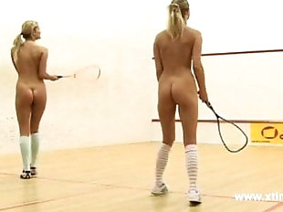 Young lesbians tennis players, playing with..